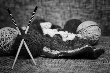 embroidery wool balls and knitting needles