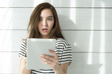 Young woman is reading the e-book