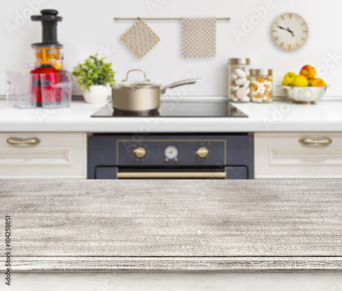 """Kitchen Table Top Material: """"Wooden Table On Defocused Kitchen Bench With Oven"""