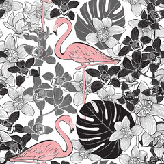 Seamless pattern with pink flamingo on the background of tropical plants.