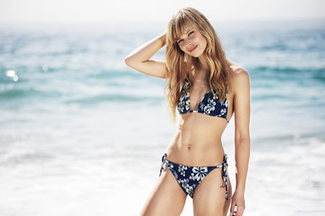 Wall Mural - Sexy young woman in bikini at beach, portrait