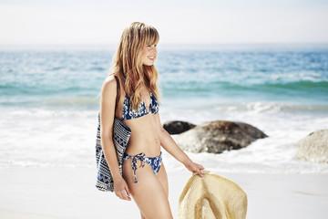 Wall Mural - Happy beach girl in bikini, smiling
