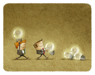 Two men holding lighted bulbs