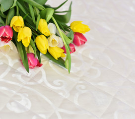 Spring Tulip Flowers in a room interior. Tulips bunch. Tulips on