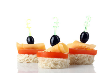 delicious canapes on a white isolated background