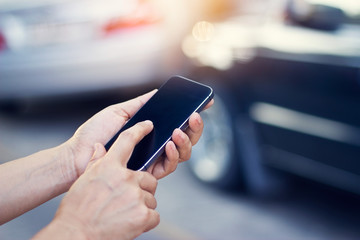 woman using smartphone at roadside after traffic accident, soft and blur