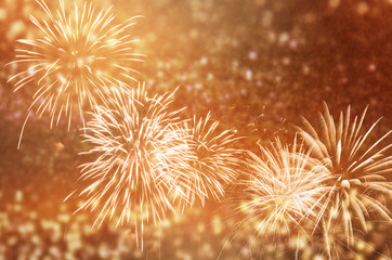 Fototapete - Defocused fireworks and bokeh at New Year and copy space. Abstract background holiday.