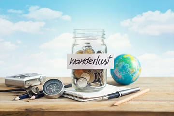 Money savings in a glass jar on blue sky background, Travel concept