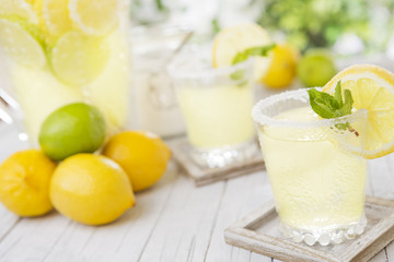 Refreshing lemonade on a rustic outdoor table in bright light