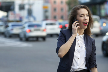 business woman winking on the phone