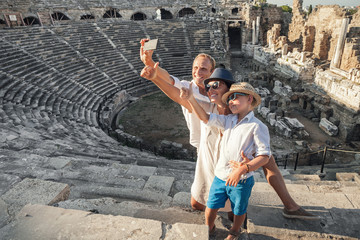 Family vacation selfie photo in antique amphitheater ruins in Si