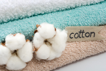 Stack of bath towels with cotton blossom