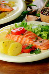 Fried salmon fillet with vegetables