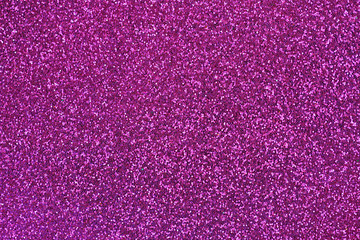 Abstract background glittery texture photo of glitter in magenta