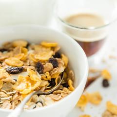 Breakfast - muesli and fruits on white background