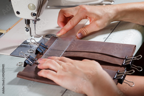 Woman's Hands On Sewing Machine Stock Photo And Royaltyfree Images Stunning Hands Free Sewing Machine