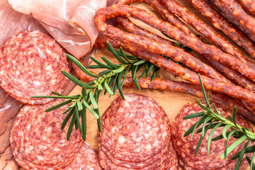 Assortment of meats. Smoked sausage, salami and prosciutto slices