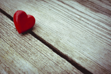 Photograph of two hearts on wooden surface