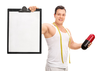 Man holding a diet pill and a clipboard