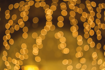 Blurred background night photo. Background out of focus. Can use as wallpaper, design. Fairy defocused photo.