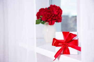 holiday concept - beautiful hydrangea flowers in vase and gift b