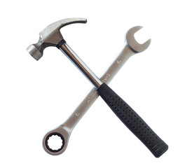 Hammer and wrench isolated on white background