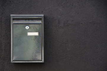 Metal mailbox hanging on wall