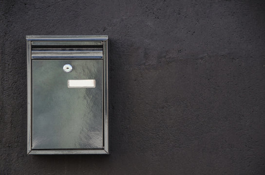 Metal mailbox hanging on wall