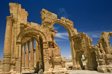 Syria. Palmyra (Tadmor). The monumental arch (gateway) and colonnade. This site is on UNESCO World Heritage List