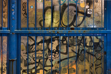 Graffiti, walkway plastic barrier, at night, Ebisu, Tokyo, Japan