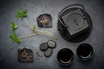 Black cast iron tea set. various tea  in Asian style