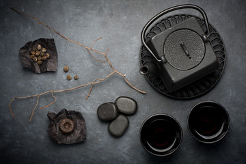 Black cast iron teapot and cups.various tea  in Asian style