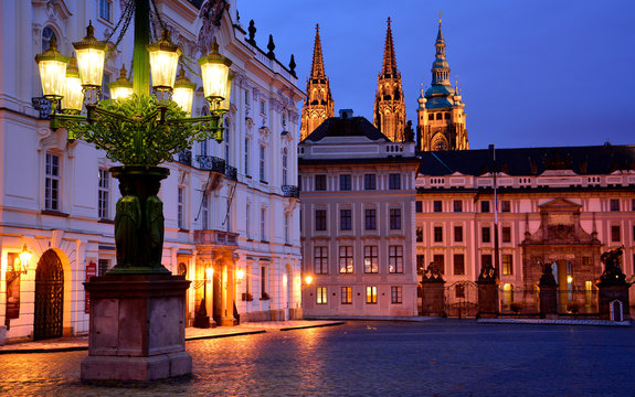 A lantern and Prague castle entrance in the evening