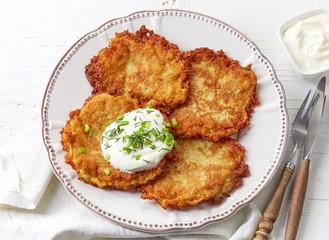 Potato pancakes on white plate