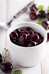 Homemade cherry sauce in white ramekin