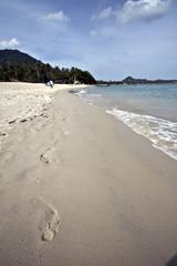 footprints on sand koh samui beach thailand