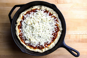 Cooking a homemade pizza in a cast iron skillet