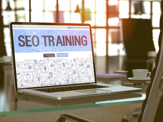 SEO Training Concept. Closeup Landing Page on Laptop Screen in Doodle Design Style. On Background of Comfortable Working Place in Modern Office. Blurred, Toned Image. 3D Render.
