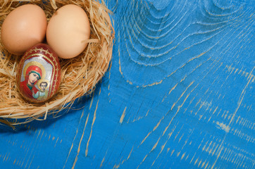 Easter composition on old wooden background