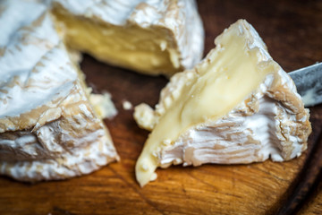 Close up of slice of  camembert cheese