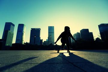 skateboarder doing an ollie trick at sunrise city