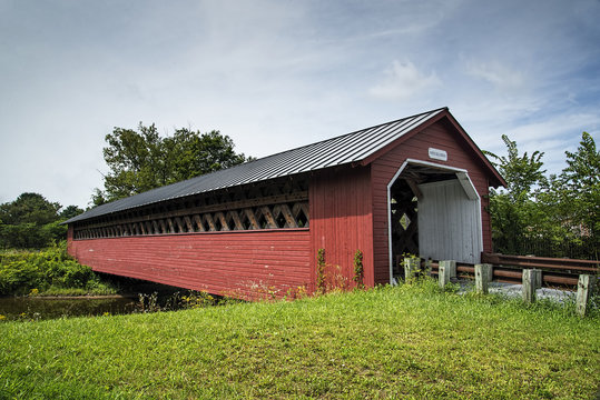 The Paper Mill Covered Bridge sparkles against a bright blue sky in Bennington County, Vermont.