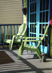 Pastel Adirondack chairs make a pleasant scene in the Catskill Mountain town of Tannersville, New York