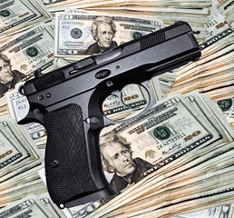 A black handgun and a pile of money.