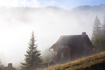 Wooden house in a fog