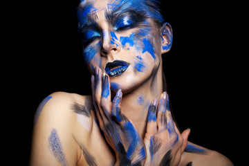 girl in blue paint on his face