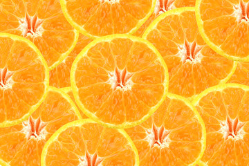 Sliced tangerine orange stacked to create fruit background.