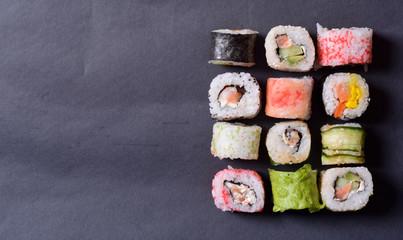 Sushi rolls on a black