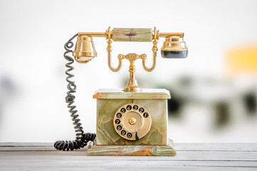 Antique telephone in gold and marble