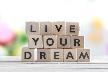 Living your dream words on a table